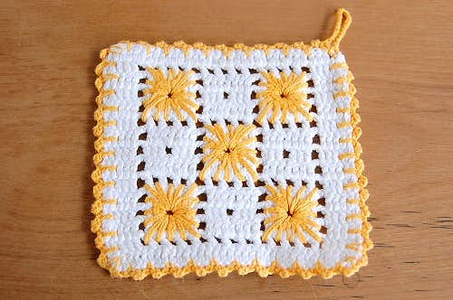 スウェーデンで見つけた手編みのポットマット(オレンジ×ホワイト)の商品写真